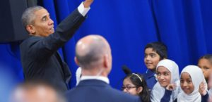 "US President Barack Obama waves after greeting attendees in an overflow room at the Islamic Society of Baltimore, in Windsor Mill, Maryland on February 3, 2016. Obama offered an impassioned rebuttal of ""inexcusable"" Republican election rhetoric against Muslims Wednesday, on his first trip to an American mosque since becoming president seven years ago. / AFP / MANDEL NGAN"