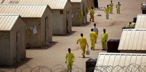 Iraqi detainees walk inside the Camp Bucca detention centre located near the Kuwait-Iraq border, on May 20, 2008.  There are approximately 22,000 detainees being held by US forces in two detention facilities in Iraq, up from only about 14,000 before the American troop surge this year.  Camp Bucca currently holds 19,070 detainees in 33 separate compounds. The detainee population contains, juveniles, insurgents of all anti-coalition groups in Iraq, and innocent Iraqis detained during military operations.  Military officials have initiated programs for the detainees in the detention facility including educational classes, Islamic discussion courses, work programs, art classes and a vigorous review board to discuss with detainees the circumstances surrounding their arrest.  AFP PHOTO/DAVID FURST