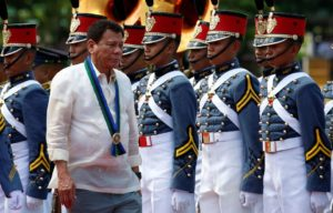 0018-philippines-president-rodrigo-duterte-walks-past-military-cadets-at-main-military-camp-aguinaldo-in-